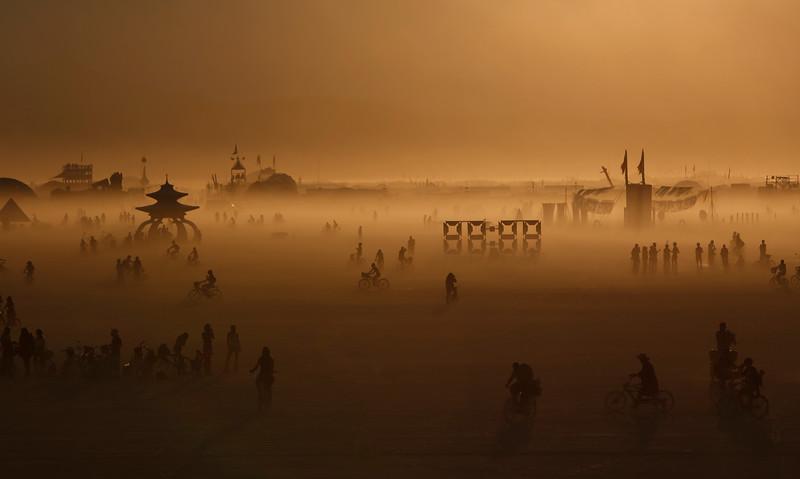 Attendees travel across the playa during the annual Burning Man festival in Black Rock Desert, Nevada on Sept. 1, 2017.