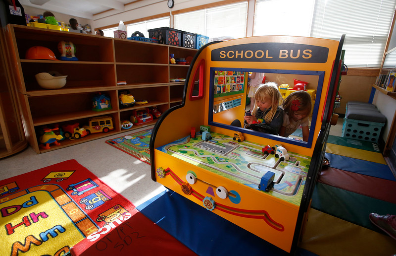 Kaylee Smith, left, and Mia Hawkins, both 4, play in a toy school bus in a classroom during an open house at Rimrock Learning Center in Billings, Mont. on Wednesday, Sept. 5, 2018.