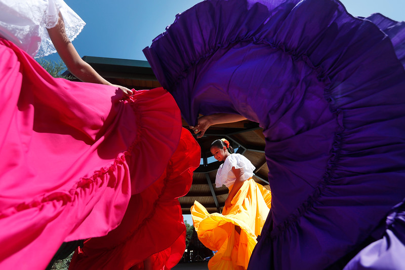 Members of The Los Guadalupaos dance troupe spin their skirts before their performance during the Mexican Fiesta in Billings, Mont. on July 28, 2018.