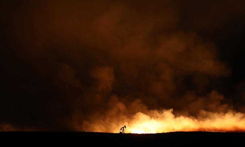 An oil well is illuminated by the Terek fire north of Worland, Wyo. on Monday, July 9, 2018. The fire, originally two fires caused by lighting strikes, burned in sagebrush and grass. The two blazes eventually joined and grew to 56 square miles.