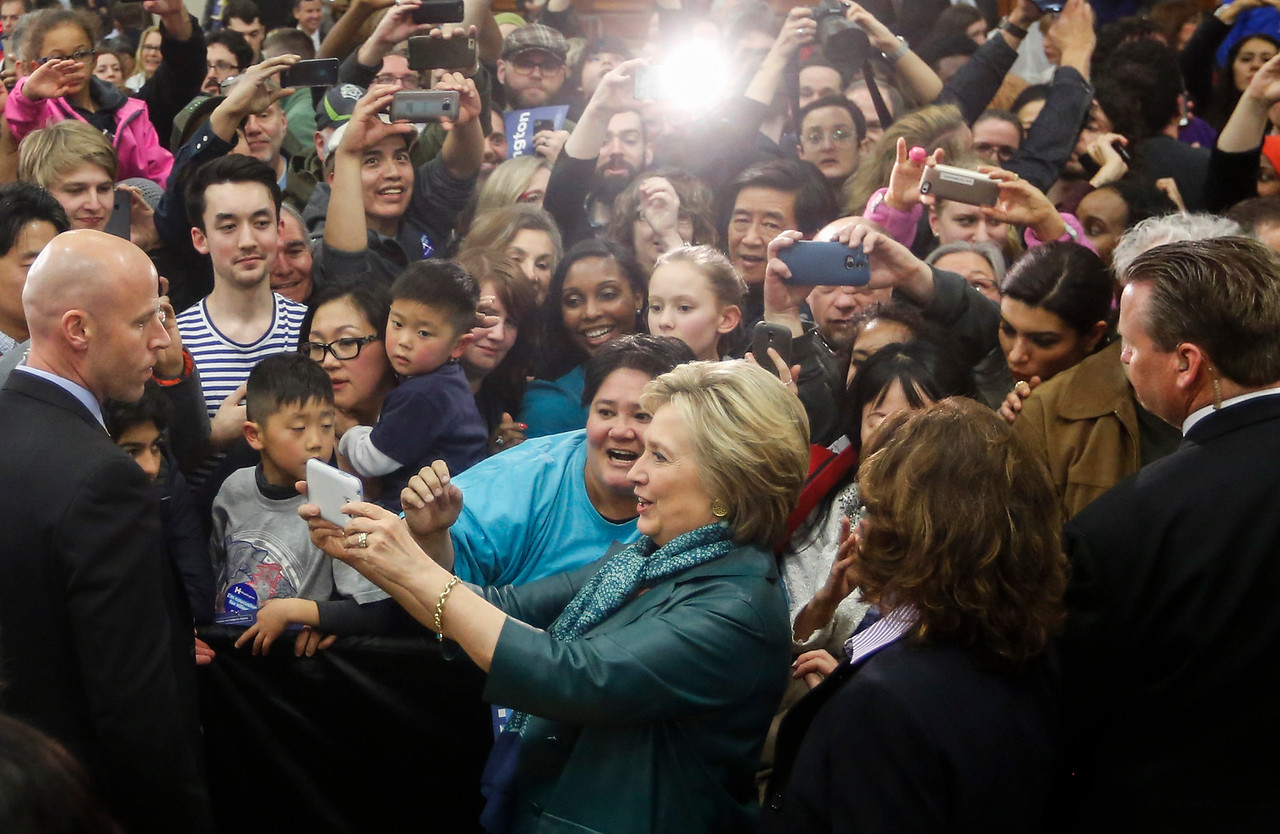 Hillary Clinton takes a selfie with supporters at Rainier High School in Seattle, Washington on March 22, 2016.