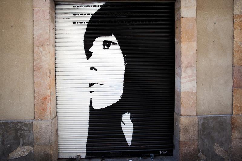GRAFFITY OF A WOMAN'S FACE. EL BORNE. BARCELONA.
