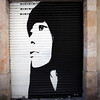 GRAFFITY OF A WOMAN'S FACE. EL BORNE. BARCELONA.