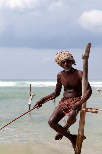 MIRISSA. SOUTH SRI LANKA. STILT FISHERMEN.