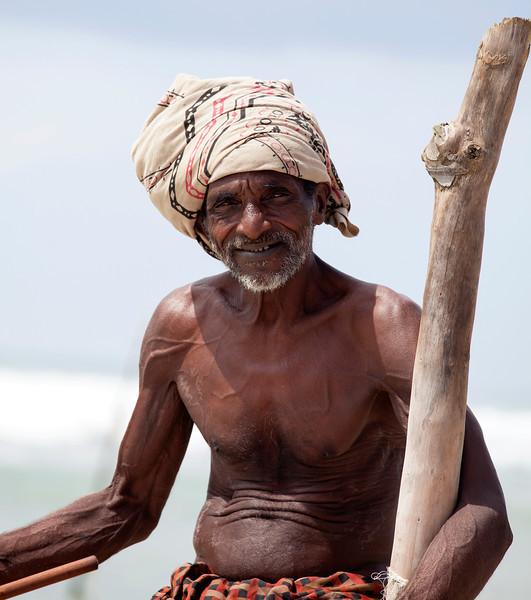 MIRISSA. SOUTH SRI LANKA. PORTRAIT OF A STILT FISHERMAN.