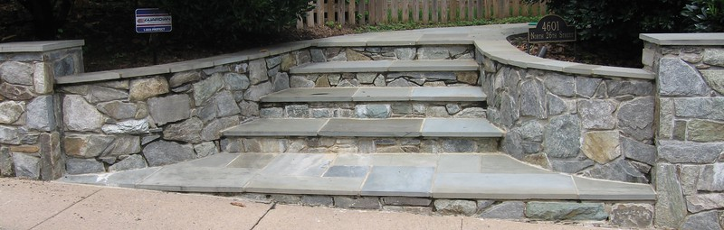 garden-stairs-with-grey-stone-tiles-on-the-steps-while-the-walls-are-decorated-with-flagstones