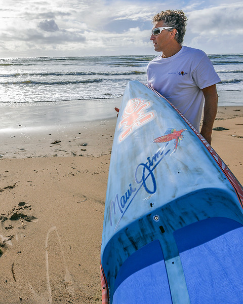 Pascal Pouget, having a look at the conditions with his Starboard