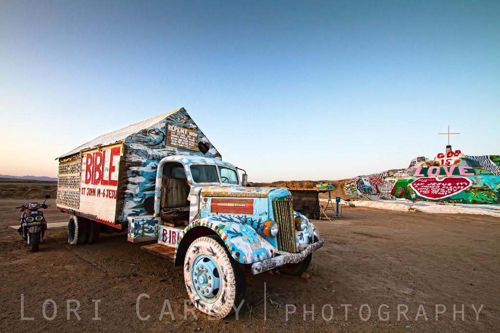 The truck that Leonard Knight called home for almost 30 years while he built and cared for Salvation Mountain (background).