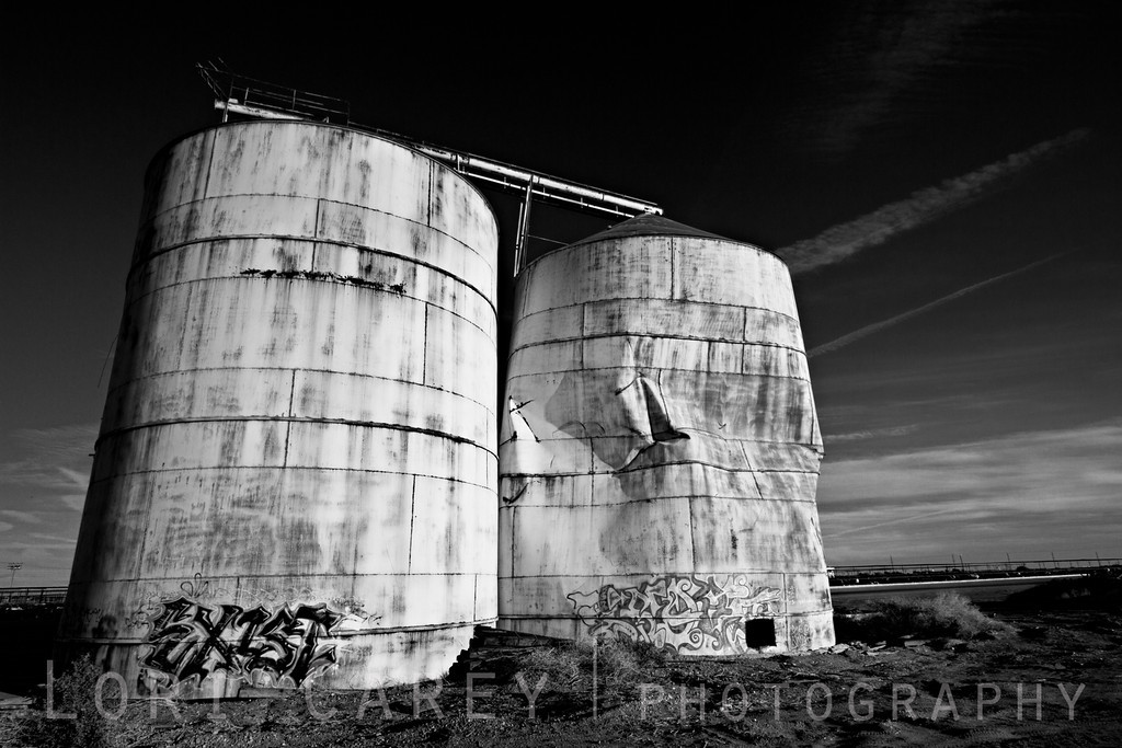 Abandoned grain silos with graffiti in Brawley, California