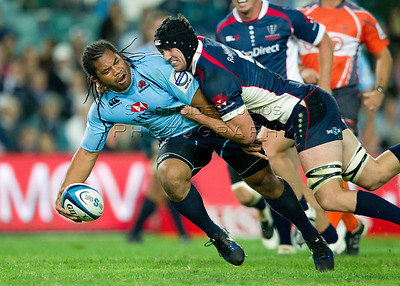 Tatafu Polota-Nau Cadeyrn Neville  Super 15 Rugby Waratahs v Rebels 1 March 2013  Tatafu Polota-Nau toffloads as Cadeyrn Neville tries to tackle him. Waratahs 31 defeated the Rebels 26 (c) MILOS LEKOVIC | StockPix.eu