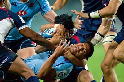 Israel Folau Shota Horie Super 15 Rugby Waratahs v Rebels 1 March 2013  Shota Horie has a firm hold on Folau. Waratahs 31 defeated the Rebels 26 (c) MILOS LEKOVIC | StockPix.eu