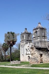 Mission Concepcion's two towers, it's well, and a palm tree (San Antonio, Texas)
