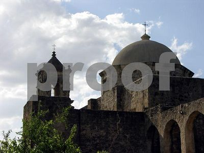 Clods over the tower and dome at Mission San Jose (San Antonio, Texas)