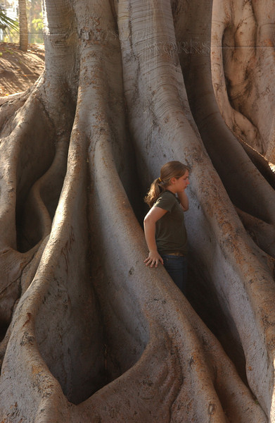 Lydia in giant Moreton Bay fig tree roots - Balboa Park, CA
