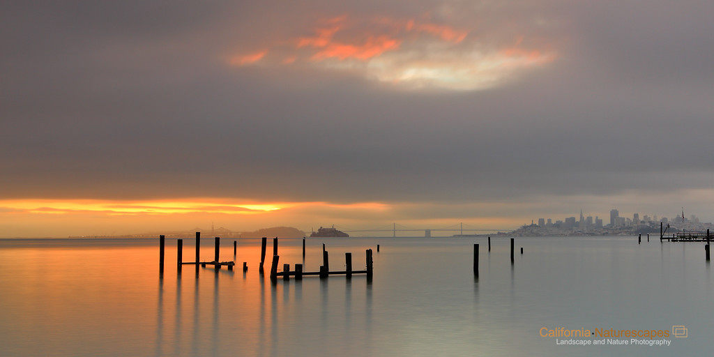 """Daybreak at Sausalito"" <br>Location: Sausalito Waterfront Area, San Francisco, California.  <p><p>I was very happy to finally capture this image. This has been on my mind for such a long time and I did visit this place a few times since then, but was never able to catch all the drama this place has to offer. The spot is usually crowded with photographers and I was not surprised to see three other photographers standing shoulder to shoulder trying to capture this very moment.   <p>Tech Info: <br>Lens: Canon EF 17-40mm f/4L @ 40mm <br>Camera: Canon EOS 5D Mk II <br>Exposure: 30sec at f/14 and ISO 50 <br>Filters: Hoya Solid ND, LEE .9 ND Grad"