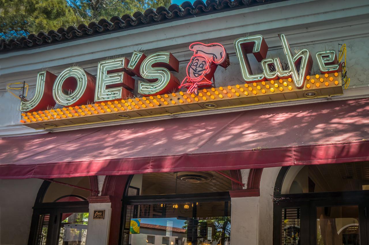 Neon sign saying Joe's Cafe