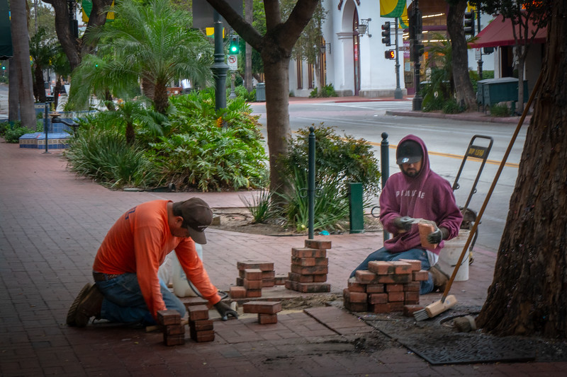 Repairing the brick sidewalk