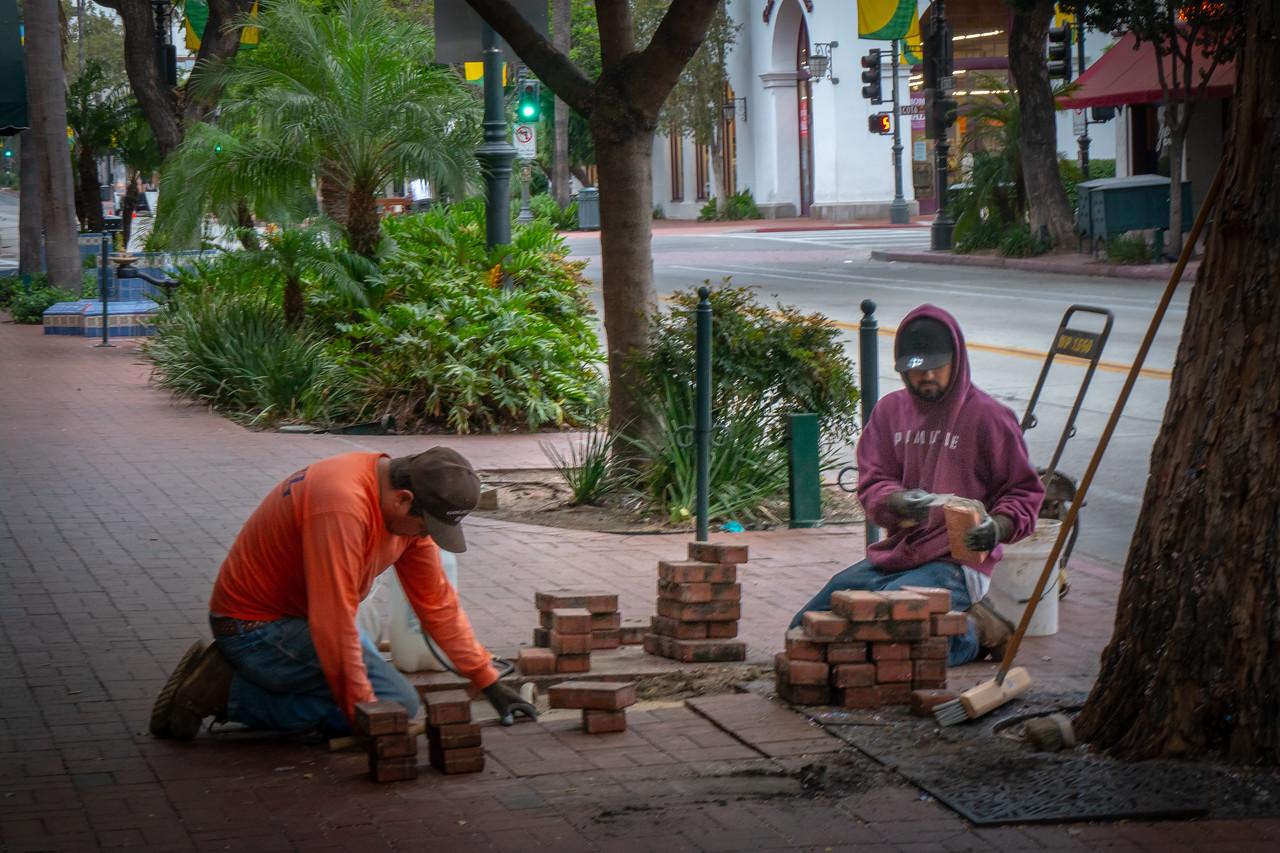 Repairing the brick sidewalk in Santa Barbara