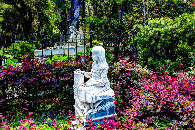 Gracie Watson. Gracie was born in 1833 as the only child of  W.J. and Frances Watson of Boston Massachusetts.  When the Watsons moved to Savannah, they took over management of the Pulaski Hotel that sat on Johnson Square. Just two days before Easter in 1889, at the age of six, she died of pneumonia. Visitors of Johnson Square say that they sometimes see a little girl, so full of energy, playing  around the bronze sundial. The Pulaski Hotel no longer exist. In it's place sits a Regions Bank. Customers and employees alike claim to hear the laughter of a little girl echoing through the building. In Bonaventure itself, Gracie can be seen playing amongst the graves of other children. Visitors of her grave leave special gifts such as coins for her. The lovely memorial sculpture behind her, inscribed with the Taliaferro family name, depicts an angel delicately gesturing toward a cross. While very beautiful, it is distressing to note that this elegantly sculpted piece has suffered quite a bit of damage, particularly on the hands and on the tops of the wings.