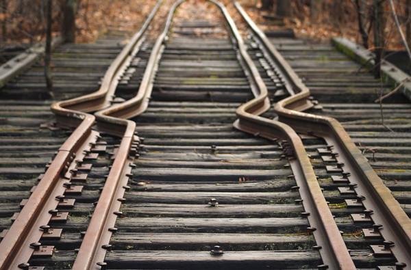 Winnipesaukee River Trail. Train tracks on Upside down bridge in Franklin, NH.