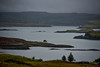 Dunvegan Castle (center in distance) and Dunvegan Ligthhouse from across Loch Dunvegan, Isle of Skye, Scotland