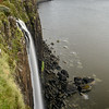 , (150ft) Isle of Sky, Scotland falling into Sound of Raasy with Kilt Rock (180ft) in the backgroung. Looks like a kilt?