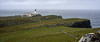 Neist Point Lighthouse, Glendale, Isle of Skye, Scotland  It was built in 1900 when it was a manned lighthouse.  The light is 43 meters above sea level and can be seen up to 16 nautical miles offshore. It was really windy and raining when this was taken.