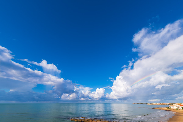 Clouds and rainbow over the sea