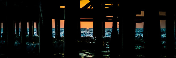 """""""Sunset Under The Pier""""  The sun dips very low under the Crystal Pier in Pacific Beach, San Diego, California."""