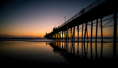 """""""You Have An Orange Glow About You""""  The Oceanside Pier at sunset. The sun is poking through the uprights in the pier. Located in Oceanside, California."""