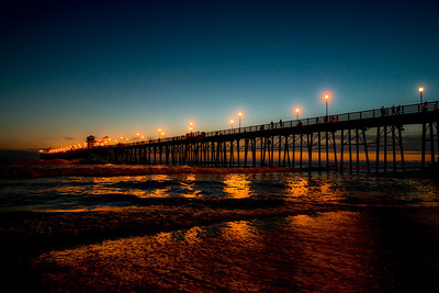 """California Cocoa""  The Oceanside Pier in Oceanside, California. Taken 26 minutes after sun down the lights on the water created the look of cocoa."