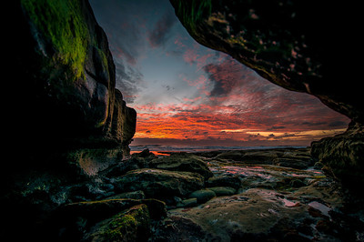"""A Crab's Eye View""  An amazing sunset view from a cave etched out by the Pacific surf. Image created in La Jolla, California. To view this on the wall of your home or business or to purchase this please visit http://paulwkoesterphotography.artstorefronts.com/store/art_print_products/CrabsEyeView"