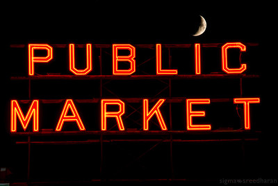 "253/365 - Moon set over the market  I caught the moon dotting the 'I"" on its way down.     Camera NIKON D800  Lens Nikkor 28-300mm  ISO 100  Focal Length 145mm (moon 300mm) Aperture f/9  Exposure Time 1s (Moon at 1/8t s)."