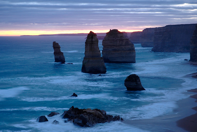 12 Apostles (One fell day before!) [Victoria, Australia]<br /> An image shot in the evening's setting sun of The Twelve Apostles, Victoria, Australia. The Twelve Apostles are located along the spectacular Great Ocean Road. They were originally named the 'Sow and Piglets'. The Twelve Apostles were formed by erosion of the original coastline. The constant action of the sea on the limestone slowly wore down the rocky cliff, gradually leaving individual rocks.<br /> <br /> This image has been used in the inside CD cover of Rick Seaton's music CD.