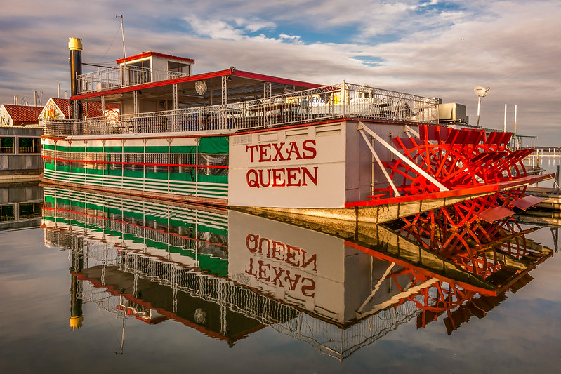 I removed some of the sun-spots near the Texas Queen name...and made it slightly more saturated with the colors.   Let me know if this one works OK for printing compared to the #2 image that is a bit lighter overall.    I found a copy that showed more of the paddle at the very end of the boat.  The previous image you had was cropped into the paddle area.   This one has been enlarged also which will make it work better for printing.    972 672 6973