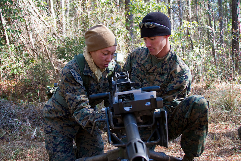 Sergeant Jaimie Wassink  and Sergeant Burkhalter perform function checks on the MK-19 automatic grenade launcher during a two-day field exercise at Sergeant's Course 1-11 in Camp Johnson, North Carolina.