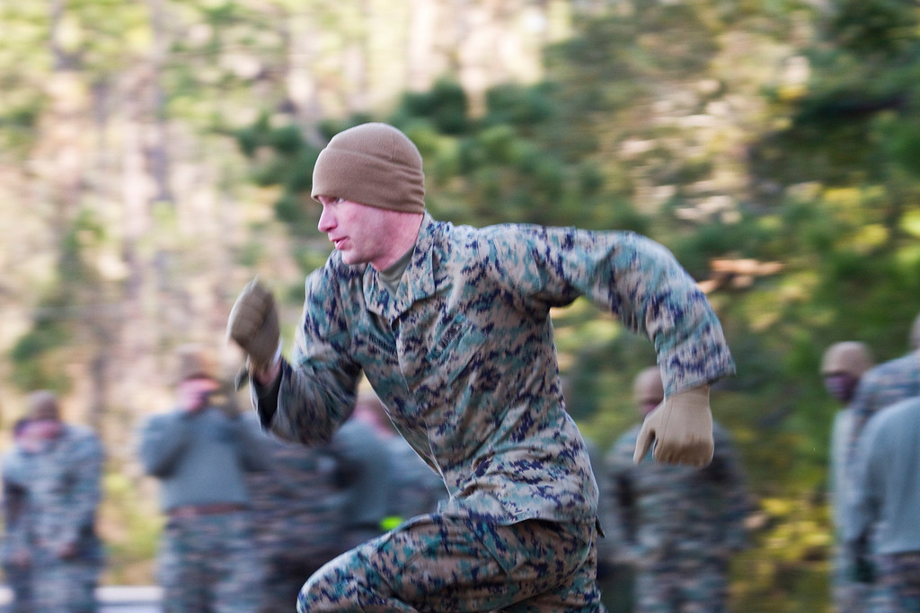 Sergeant Charles Garrett, member of 6th Platoon, sprints towards his next objective during the Combat Fitness Test, one of the last training evolutions at Sergeant's Course 1-11, Camp Johnson, North Carolina.