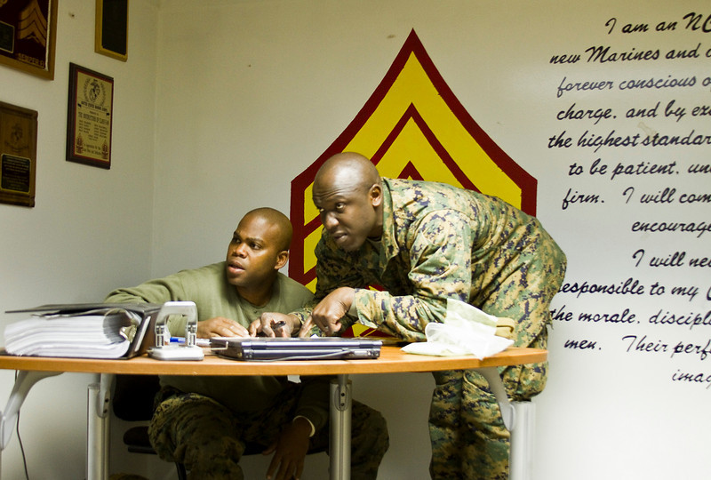 Two Marine sergeants review for an upcoming exam at Sergeant's Course 1-11 in Camp Johnson, North Carolina.