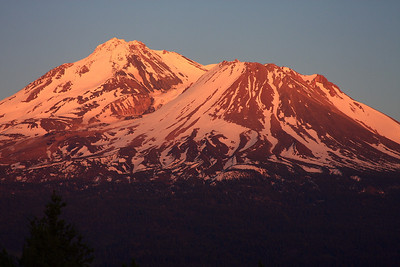 The cones of Mount Shasta come alive during sunset. Taken from Lake Shastina