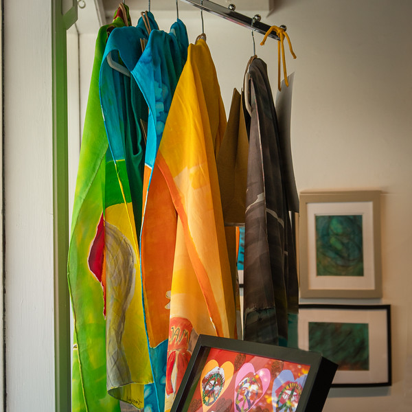 Silk scarves brighten the window at the Showcase Gallery