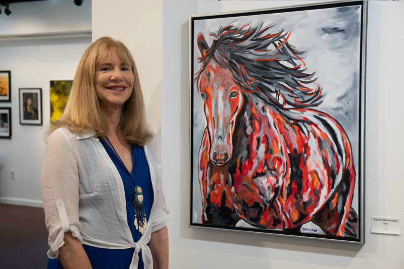 "Artist Denise Messenger with her painting, ""Red."""