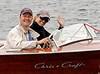 Enjoying Their Classic Wood Boat