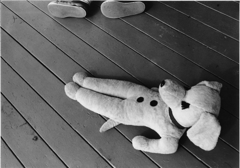 "Image 23 - taken by Wes, age 6. ""Naptime on Block Island"" - Abe was asleep on the porch, his shoes at top of image; Abe's stuffed animal [""Bodger""] in the foreground."