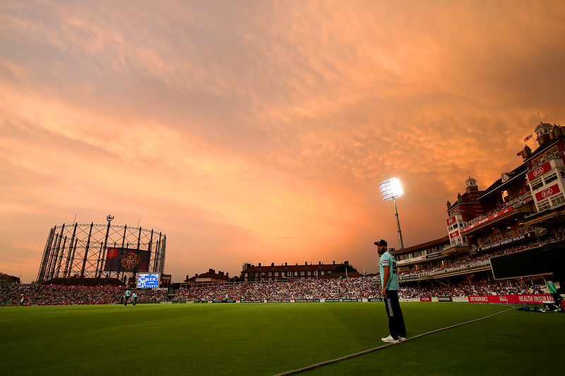 Imran Tahir of Surrey stands on the boundary edge as the sun sets during the Vitality Blast match between Surrey and Glamorgan at The Kia Oval on July 25, 2019 in London, England.