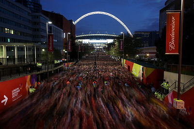Fans leave the stadium down Wembley Way after the FA Cup Semi-Final match between Wigan Athletic and Arsenal at Wembley Stadium on April 12, 2014 in London, England.