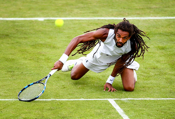 An acrobatic Dustin Brown reaches for a ball during the Aegon Surbiton Trophy at Surbiton Racket & Fitness Club on June 7, 2016 in Surbiton, England.