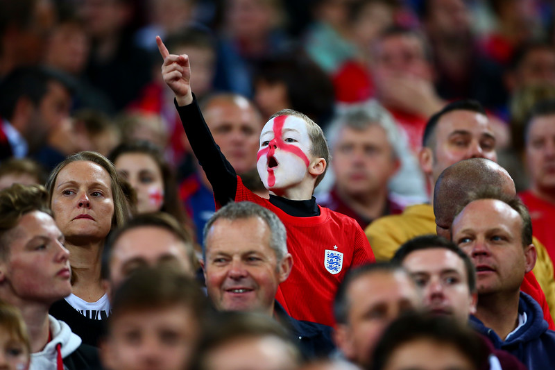 A young England cheers during the UEFA EURO 2016 match between England and Switzerland at Wembley Stadium on September 8, 2015 in London, United Kingdom.