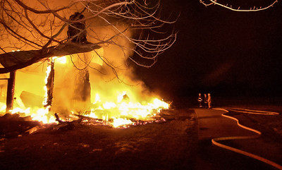 Firefighters wait for the blaze to burn itself out at 1469 Possum Run Road.