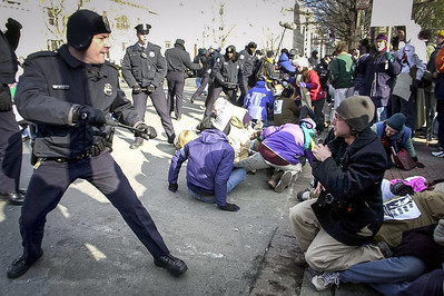 An out of control police officer prepares to engage the crowd after a peaceful sit-it turns a little astay in front of Lafayette Park in Washington D.C.