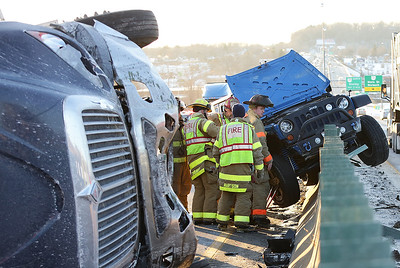 Firefighters respond to an overturned egg truck on U.S. 30 which scrambled traffic for miles on February 13th, 2015